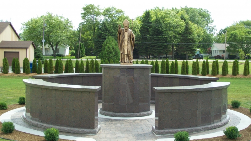 Circular columbaria garden with statue for cremated remains
